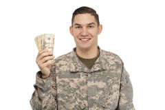 Happy soldier with money Stock Images
