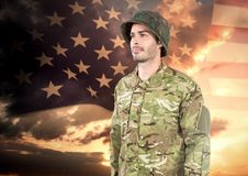 Happy soldier standing on american flag background Stock Photos