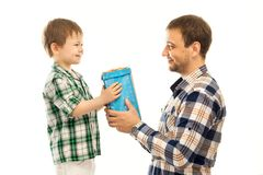 Happy son gives his father gift royalty free stock photography