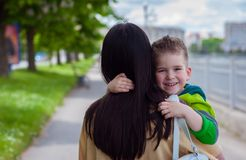 Happy son and mother. Walking on street Royalty Free Stock Image