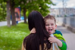 Happy son and mother. Walking on street Stock Photography