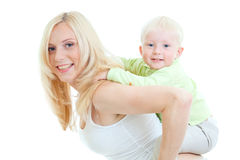 Happy son sitting on mother's back Royalty Free Stock Photos
