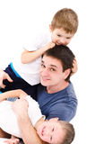 Happy sons and father Stock Photos