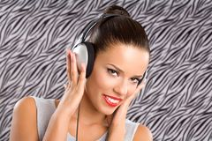 Happy sounds. Headshot of a beautiful smiling young woman with headphones Stock Photography
