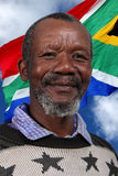 Happy South African Man and Flag Royalty Free Stock Image
