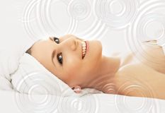 Happy spa with water drops. Picture of happy lady in massage salon with waterdrops Royalty Free Stock Photo