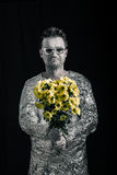 Happy spaceman with flowers. Portrait of happy spaceman holding flowers Stock Photography