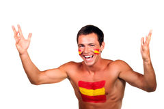 Happy spanish football fan. Cheerful happy spanish football fan with flag on his body and face, isolated on white stock photo