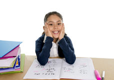 Happy spanish little school girl with notepad smiling in back to school and education concept Royalty Free Stock Photos