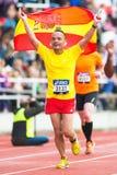 Happy spanish man running and waving the spanish flag. STOCKHOLM - MAY 31: Happy spanish man running and waving the spanish flag in the final stretch at Royalty Free Stock Image