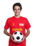 Happy spanish soccer fan with black hair and ball Stock Photography