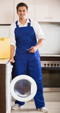 Happy specialist with tooling near washing machine Royalty Free Stock Photo
