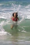 Happy splash!. Happy teen girl at the beach royalty free stock photo