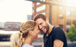 Happy spontaneous couple share a good joke Royalty Free Stock Image