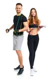 Happy sport couple - man and woman with with ropes on the white Stock Photo