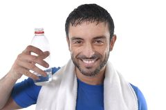 Happy sport man posing corporate with water and towel for fitness center Stock Images