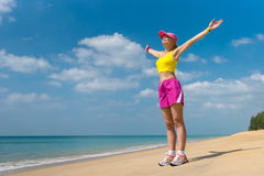 Happy Sport Woman on the Beach Stock Photos