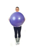 Happy sport woman holding pilates ball Royalty Free Stock Image