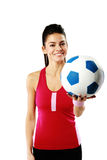 Happy sport woman holding a soccer ball Stock Image