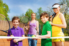 Happy sportive family with tennis apparel Royalty Free Stock Image