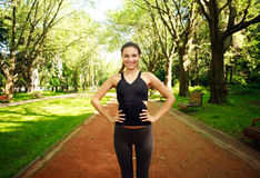 Happy sportive fit young woman in summer park Royalty Free Stock Photography