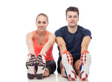 Happy sportive man and woman. Sport, fitness, lifestyle and people concept - happy sportive men and woman Stock Photo