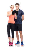 Happy sportive man and woman with tablet pc. Sport, fitness, technology, lifestyle and people concept - happy sportive men and women with tablet pc computer Royalty Free Stock Photos