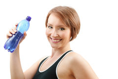 Happy sportive woman. Tired but happy sportive woman drinking water from blue bottle after training isolated on white Royalty Free Stock Images