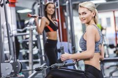 happy sportive women working out royalty free stock photography