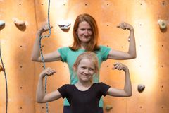 Happy sports family. Fun happy sports family. smiling mom and daughter on bouldering wall background stock photo