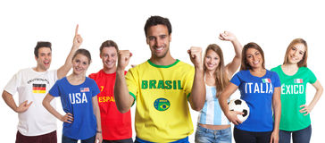 Happy sports fan from Brazil with other fans. From Germany, USA, Spain, Mexico, Italy and Argentina on an isolated white background for cutout royalty free stock photo