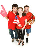 Happy Sports Fans. Group of happy sports fans - father, daughter, and her boyfriend - cheering for their football team.  Full body isolated on white Stock Photo