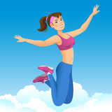 Happy sports girl jumping in the air on a background sky. Stock Photos