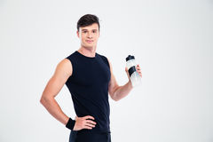 Happy sports man holding bottle with water Stock Images