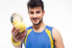 Happy sports man holding medal and tennis ball Stock Photography