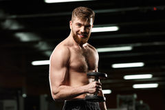 Free Happy Sports Man Make Sport Exercises With Dumbbells Royalty Free Stock Photo - 92604655