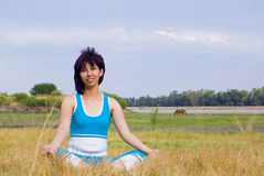 Happy sports woman. Relaxes outdoors stock photography