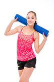 Happy sports woman holding yoga mat Stock Image