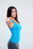 Happy sports woman pointing finger at camera Royalty Free Stock Image