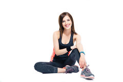 Happy sports woman sitting on the floor Royalty Free Stock Image