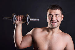 Happy sportsman is in gym Royalty Free Stock Images