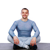 Happy sportsman sitting in the lotus position Stock Images