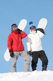 Happy sportsman with snowboards Royalty Free Stock Images