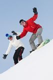 Happy sportsman with snowboards Royalty Free Stock Photo