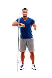 Happy sportsman standing with barbell Royalty Free Stock Photography