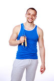 Happy sportsman standing with jumping rope Royalty Free Stock Photos