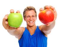 Happy sportsman with two apples Stock Photo