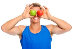 Happy sportsman with two apples Stock Photos