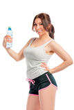 Happy sportswoman with a bottle of water Stock Photos