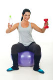 Happy sportswoman giving water and barbell Royalty Free Stock Photos